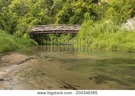Thompson Creek Bridge - A wooden footbridge crossing a creek.