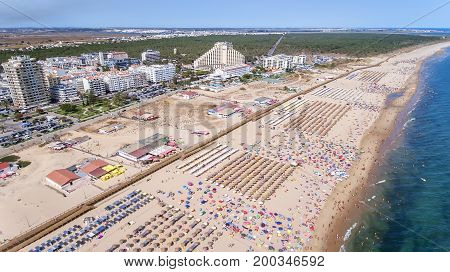 Aerial. Amazing beach of Monte Gordo is taken from the sky by drones.