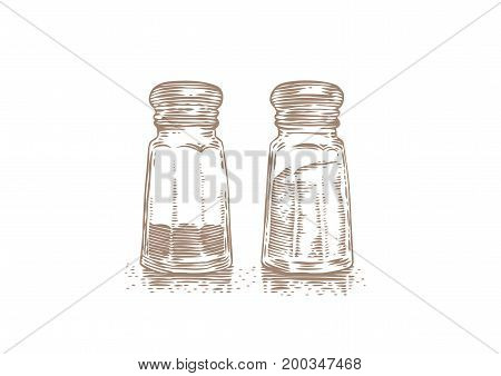 Glass salt shaker and peppermill on the white background
