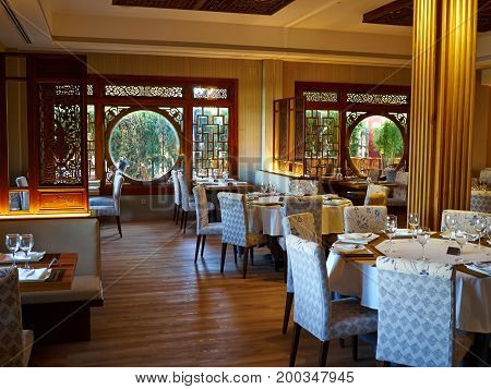 Typical fancy Chinese restaurant with classical traditional decorations and furniture