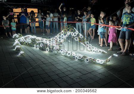 Glowed Human Body Art Installation At Annual Light Show