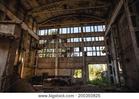 Large abandoned factory building or warehouse, ruined Soviet factory