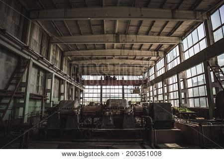 Large dark abandoned factory inside interior, abandoned industrial background, toned
