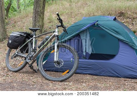 Bike With Saddlebags In Front Of Tent.