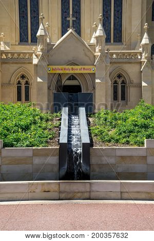 Small cascade fountain at St Mary's Cathedral front entrance at Victoria Avenue Perth City Western Australia
