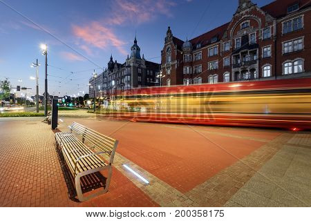 Central part of Katowice and the tram light trails during sunset. Poland