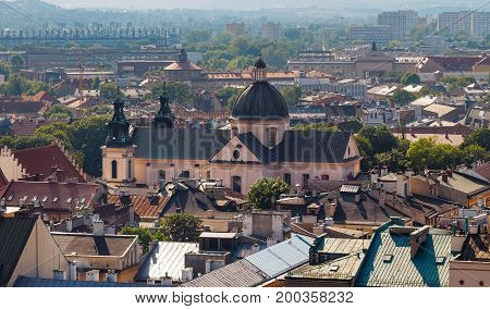 View on the roofs and the church in evening time. Krakow. Poland