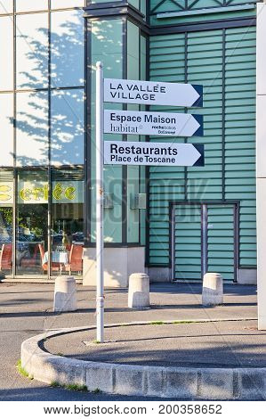 MONTREAL CANADA - JULY 30 2017 : Sign direction to La Vallee Village. La Vallee Village is one of the Collection of nine Chic Outlet Shopping Villages by Value Retail.