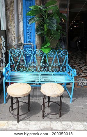 Vintage blue iron furniture at Jaffa flea market district in Tel Aviv-Jaffa, Israel.