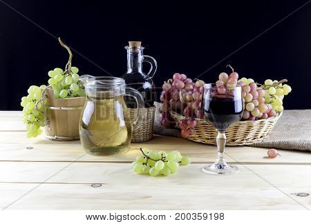 A jug of wine and grapes on a close-up table