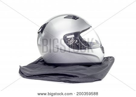 New silver motorcycle helmet on a white background closeup