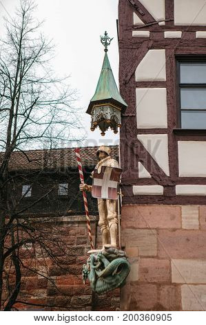 Sculpture of a knight in armor on the facade of a house in Nuremberg, Germany.