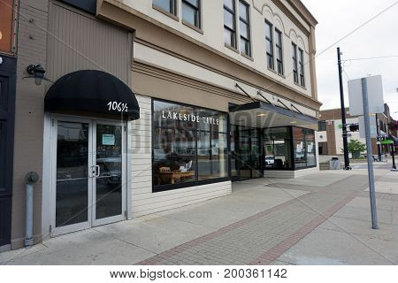 CADILLAC, MICHIGAN / UNITED STATES - MAY 31, 2017: Lakeside Title offers services involved in the closing of real estate transactions, on Mitchell Street in Downtown Cadillac.