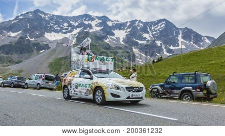 Col du Lautaret France - July 19 2014: The vehicle of RAGT Semences during the passing of the advertising caravan on mountain pass Lautaret during the stage 14 of Le Tour de France 2014. Before the appearance of the cyclists there is a caravan of advertis