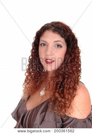 A portrait of a beautiful smiling woman with curly brunette hair in profile isolated for white background.