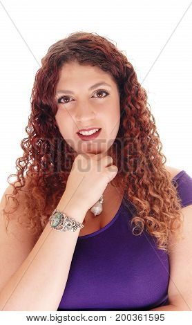 A closeup portrait of a beautiful woman with curly brunette hair whit her hand under her chin isolated for white background