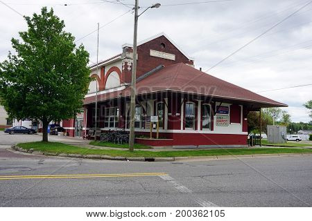 CADILLAC, MICHIGAN / UNITED STATES - MAY 31, 2017:  One may drink coffee and eat meals at the After 26 Depot Café, in the building of the old Cadillac train station, near downtown Cadillac.