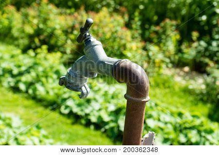 old water valve pipe for water in garden hot summer