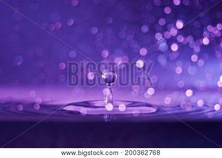 Macro shot of water drop with beautiful bokeh on background