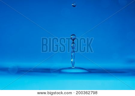 Macro shot of water drop with blue background