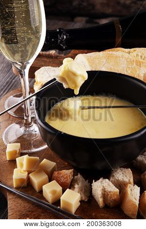 Gourmet Swiss Fondue Dinner On A Winter Evening With Assorted Ch