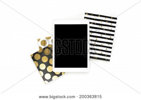Flat Lay Photo Of Office White Desk With Tablet And Stylish Gold Notebook Copy Space Background