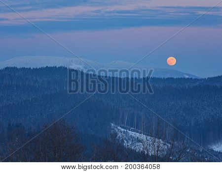 Winter Landscape In The Mountains At Night. A Full Moon And Starry Sky.