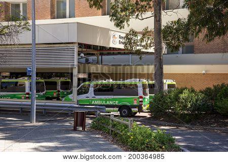 WESTERN AUSTRALIA, PERTH - NOVEMBER 2016: Ambulance vehicles parked at Emergency Department entrance Royal Perth Hospital