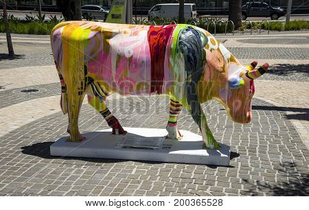 WESTERN AUSTRALIA, PERTH - NOVEMBER 2016: Colorful strip painted cow as part of CowParade event