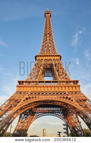 PARIS FRANCE - MAY 10 2017 : The Eiffel Tower in the evening scenic view. The Eiffel Tower is a wrought iron lattice tower on the Champ de Mars in Paris France