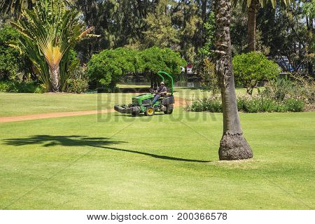WESTERN AUSTRALIA, PERTH - NOVEMBER 2016: A lawnmower cutting grass in a Government House landscaped park