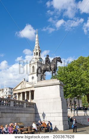 LONDON ENGLAND - MAY 13 2017 : Statue of King George IV at Trafalgar Square. The square is a public square in the City of Westminster Central London.