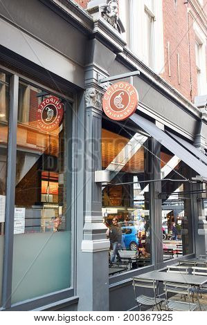 LONDON ENGLAND - MAY 13 2017 : Chipotle Mexican Grill signage and storefront. The company is an American chain of fast casual restaurants in the United States United Kingdom Canada Germany and France