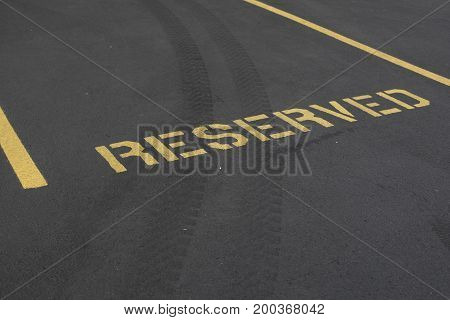 A reserved parking spot painted in yellow