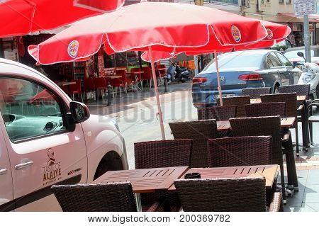 A typical street cafe on one of the main streets of the city (Alanya, Turkey) in July, 2017.