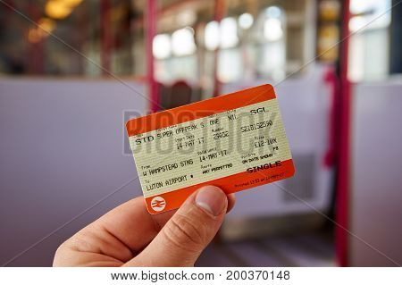LONDON ENGLAND - MAY 14 2017 : UK Rail National single offpeak standard ticket. In the United Kingdom National Rail is the trading name licensed for use by the Rail Delivery