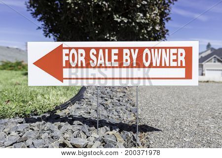 For sale by owner sign with blurred background