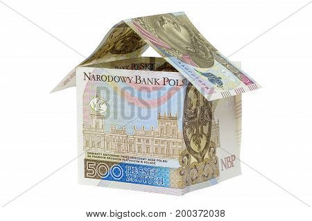 Model house made from 500 pln banknotes isolated on white background with clipping path