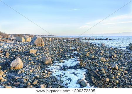 Rocky Fairhaven coastline near low tide on Buzzards Bay
