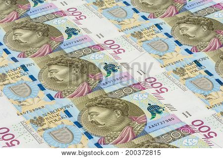 Background made of 500 pln banknotes laying in a row
