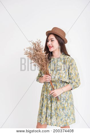 Beautiful young Asian woman with vintage style on white background