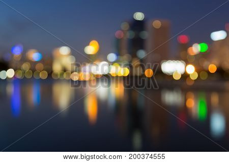 City night light blurred bokeh with reflection abstract background