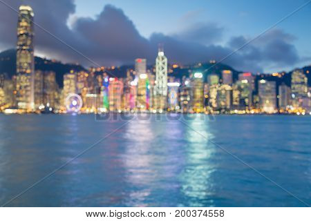 Twilight blurred bokeh Hong Kong city downtown over the bay abstract background