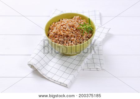 bowl of cooked buckwheat on checkered dishtowel
