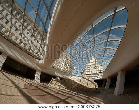 SOFIA, BULGARIA - JULY 31, 2017: the Largo, an architectural ensemble of three Socialist Classicism edifices, seen through the structure of modern glass dome, Bulgaria