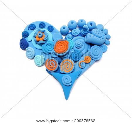 Blue heart. Color plasticine. Abstraction. Heart made of plasticine