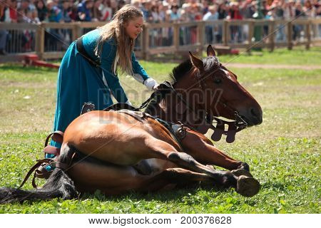 ST. PETERSBURG, RUSSIA - JULY 9, 2017: Women in medieval clothes with a horse during the military history project Battle On Neva. The main event this year is jousting tournament