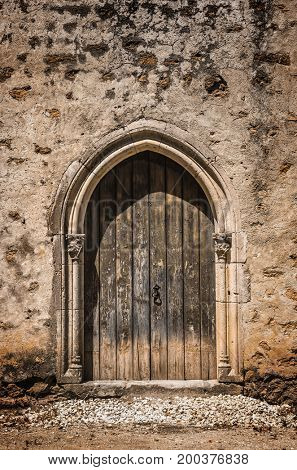 Gothic design of closed wooden door in a medieval castle
