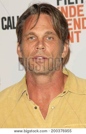 LOS ANGELES - AUG 15:  Chris Browning, wife Chrissy at the