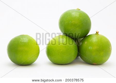 Green fresh limes on white background isolated